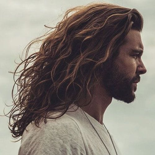 beachy side parted long hairstyles for men