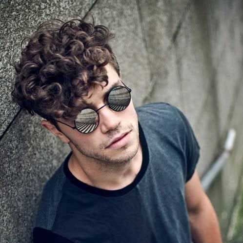 muted curly medium length hairstyles for men