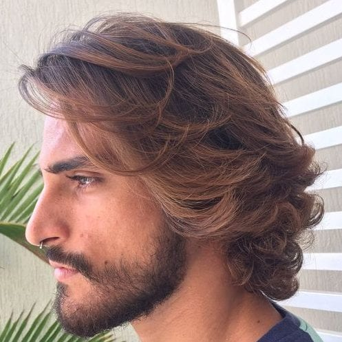 blond brushed back waves medium length hairstyles for men