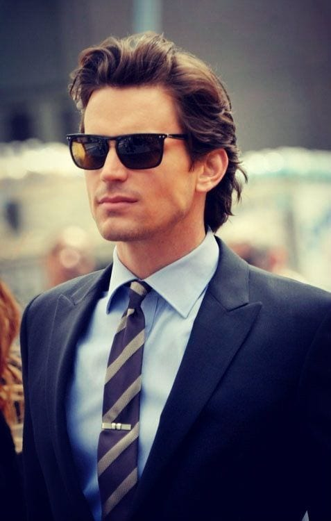 casual slicked back medium length hairstyles for men