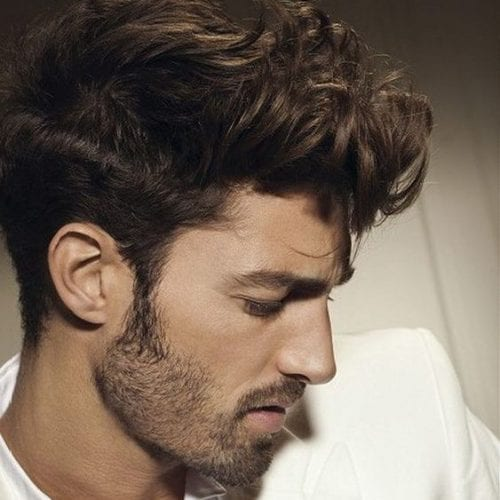 Luxurious curly faux hawk for men with stubble beard