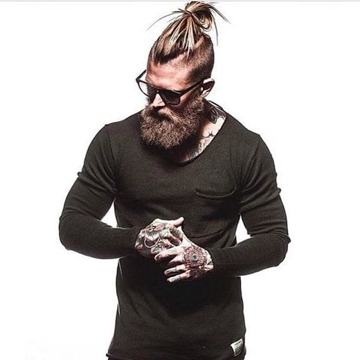 man bun with undercut and long blonde beard