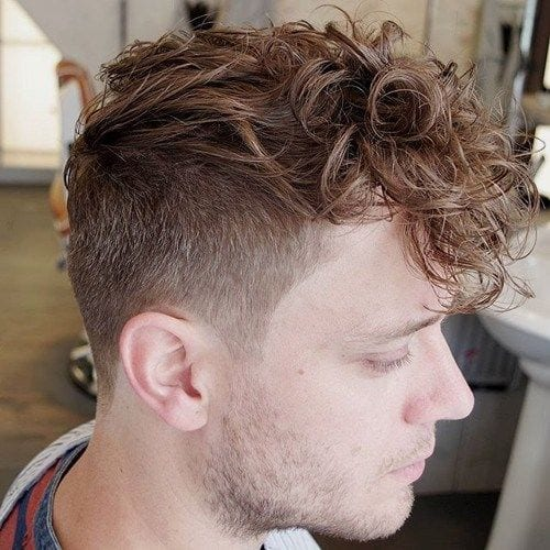 curly pushed pomp hairstyles for men