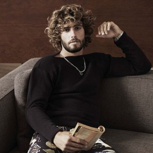 relaxed curls with bangs medium length hairstyles for men