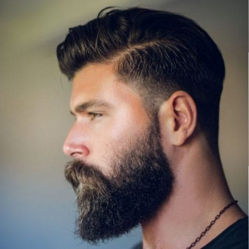 Stylish side parted pompadour + full beard