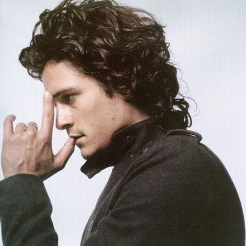 relaxed pushed back curly medium length hairstyles for men