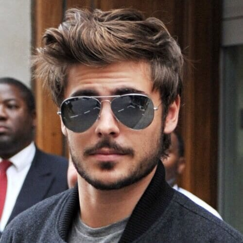 Modern Pompadour Hairstyle for Men with Wavy Hair