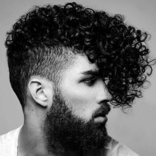 Curly Fringe Flat Top Haircut with full dark beard and undercut