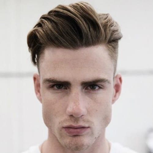 Elegant Blow Back Haircut With Shaved Sides