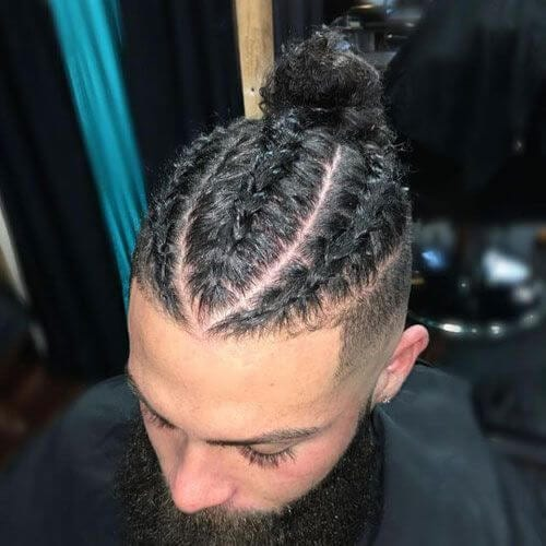 Man Braid Bun Black Hairstyle