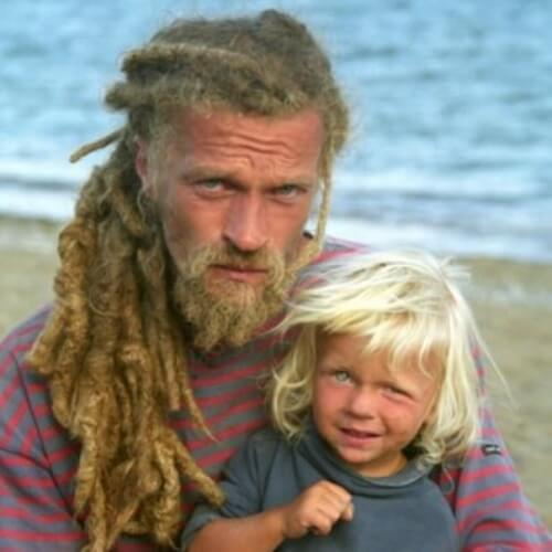 blonde dreadlocks guy with kid