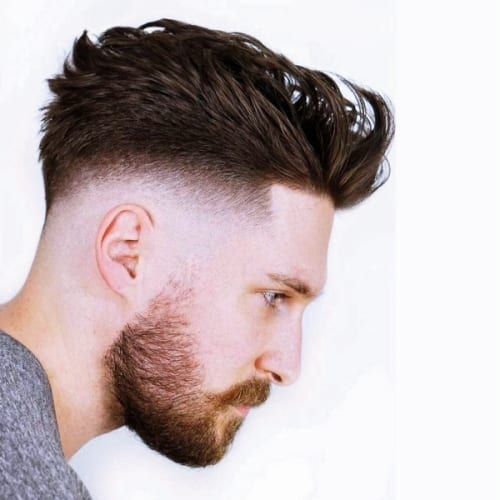 neatly groomed beard and bald fade
