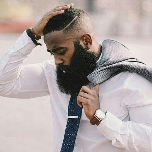 hard part bald fade with beard
