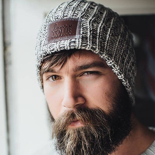man with bushy beard and beanie