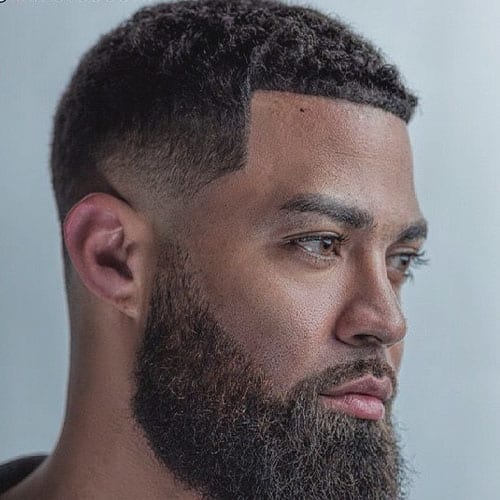 Full Beard, Neatly Trimmed, with Acute Backwards Fade