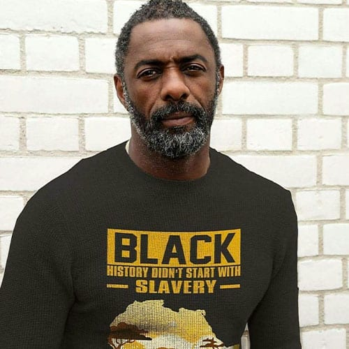 idris elba with beard in a black shirt - beard styles