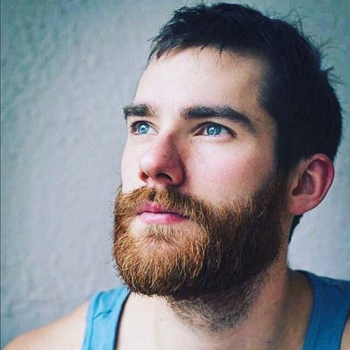 Man with beard in blue tank top