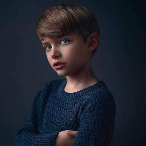 boy with medium length manicured haircut