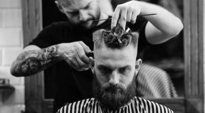hairstylist giving a man a haircut
