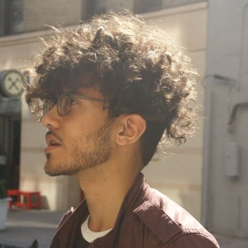 Angular Fringe Hairstyle for Men with Curly Hair